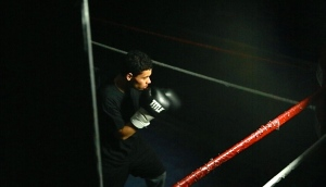Aspiring professional fighter, Manny Antonetty, shadow boxes in an empty gym